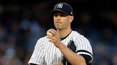 J.A. Happ of the Yankees looks on against