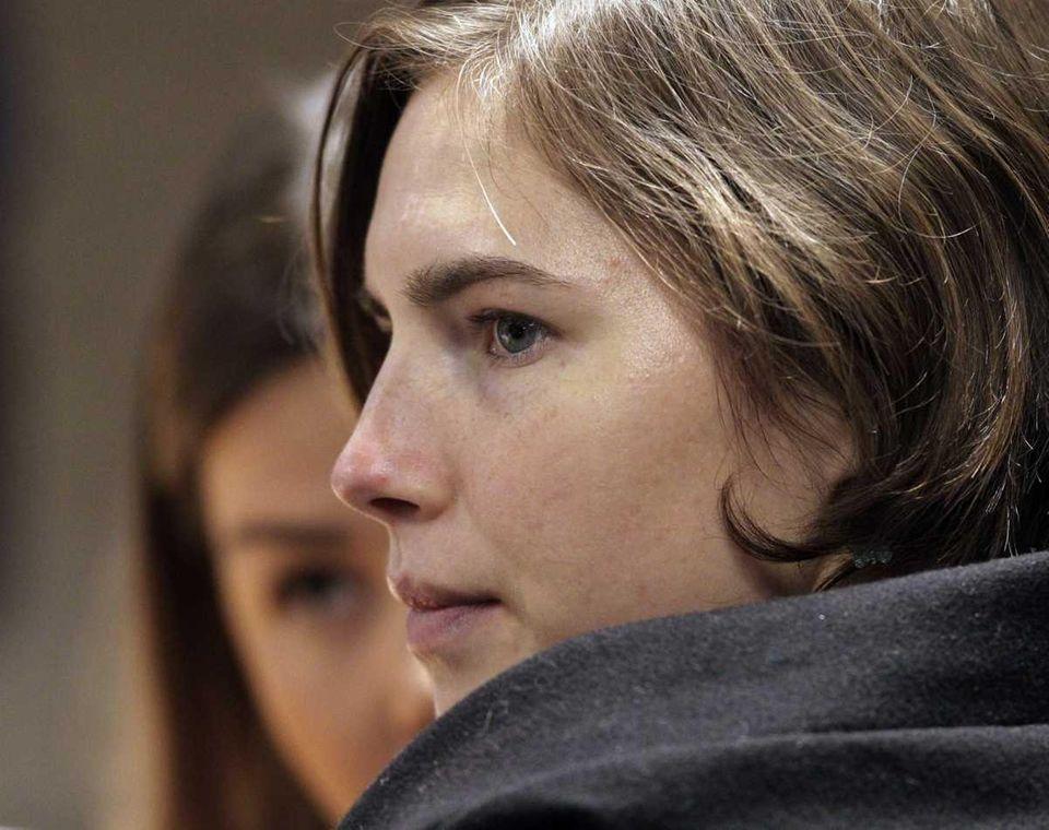 American student Amanda Knox, 23, sits next to