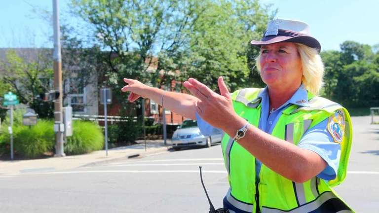 Kelly Cummings directing traffic at the intersection of