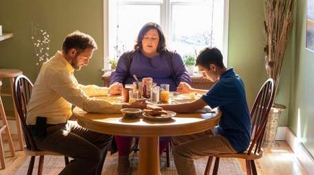 Josh Lucas, left, Chrissy Metz and Marcel Ruiz