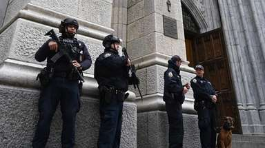 NYPD officers outside St. Patrick's Cathedral Thursday.