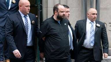 NYPD detectives walk Marc Lamparello, center, to a