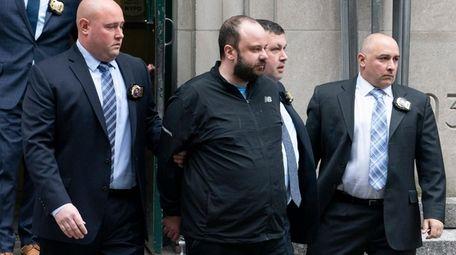 NYPD detectives walk Marc Lamparello, center, to a