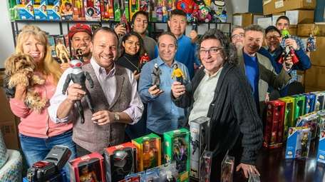 Marty Abrams, front right, CEO of Mego Corp.,
