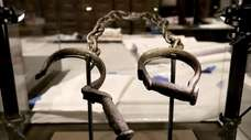 A pair of slave shackles are on display