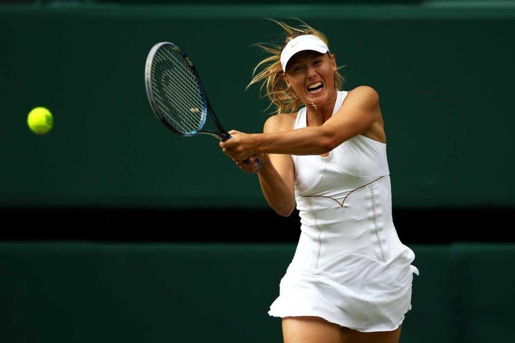 Maria Sharapova of Russia returns a shot during