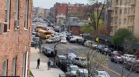 An NYPD officer was shot, a suspect was