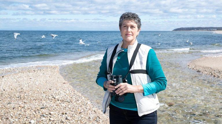 Louise Harrison, of Peconic, a conservation biologist, studies