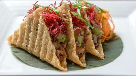 Peking duck tacos are served at View in