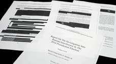 Four pages of the Mueller report lay on