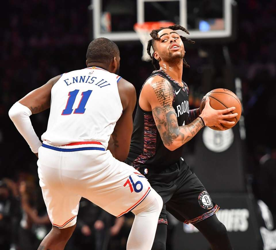 76ers forward James Ennis III (11) defends Nets