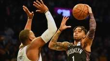 Nets guard D'Angelo Russell (1) drives up court