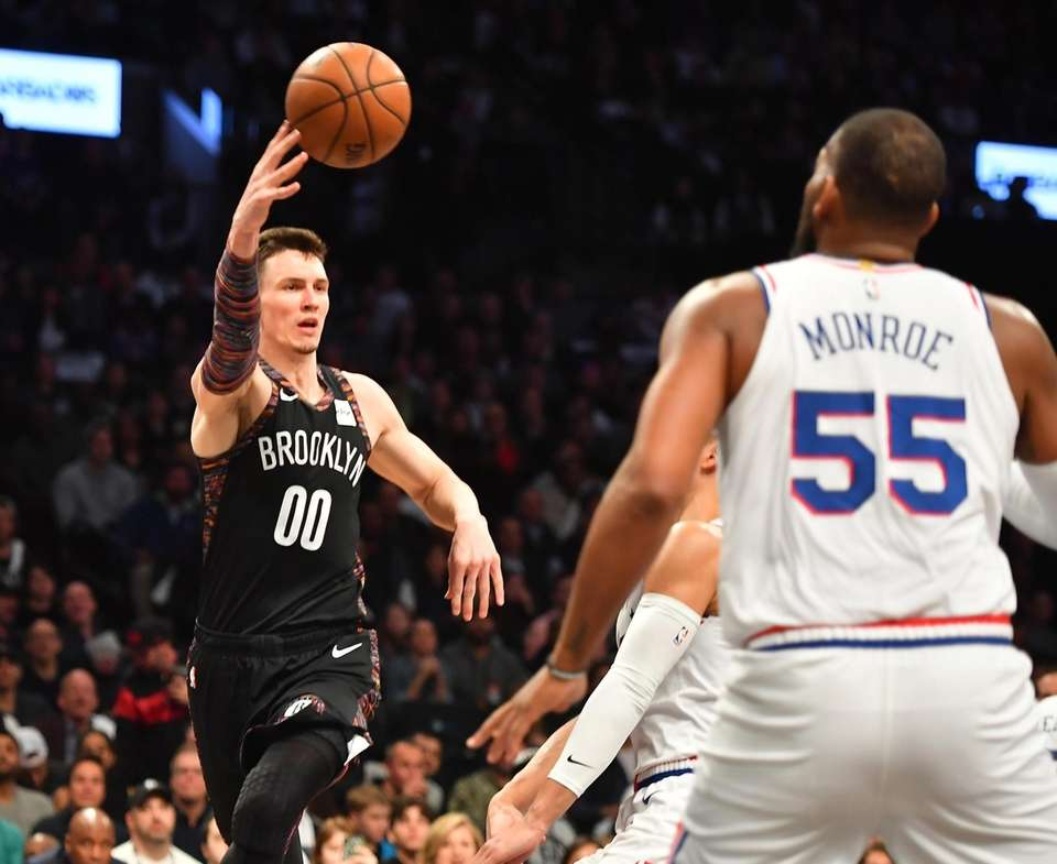 Nets forward Rodions Kurucs (00) throws the pass