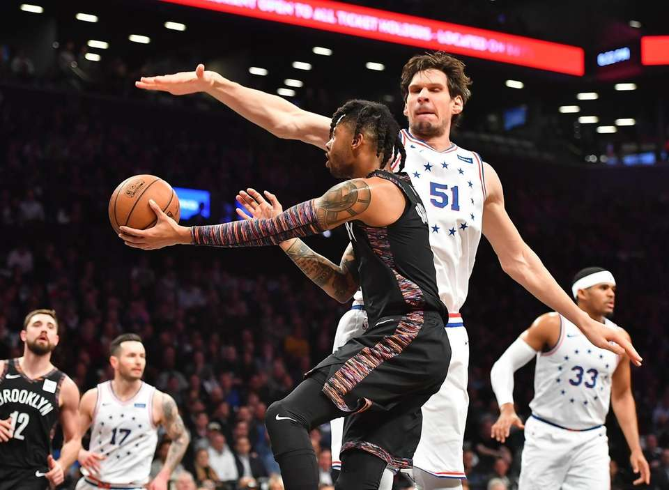 Nets guard D'Angelo Russell (1) drives around 76ers