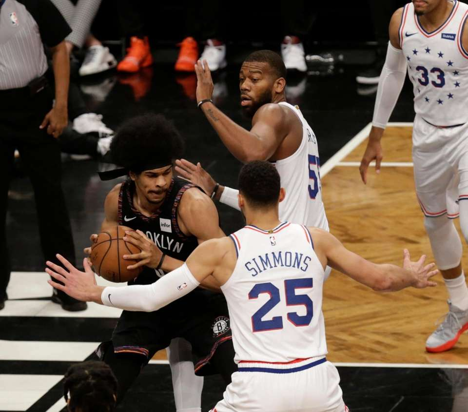 Nets center Jarrett Allen (31) is double teamed