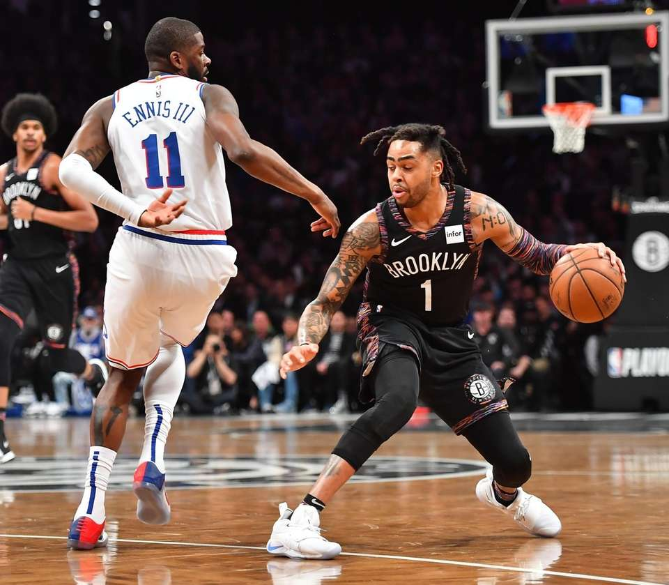 76ers forward James Ennis III (11) defends Nets