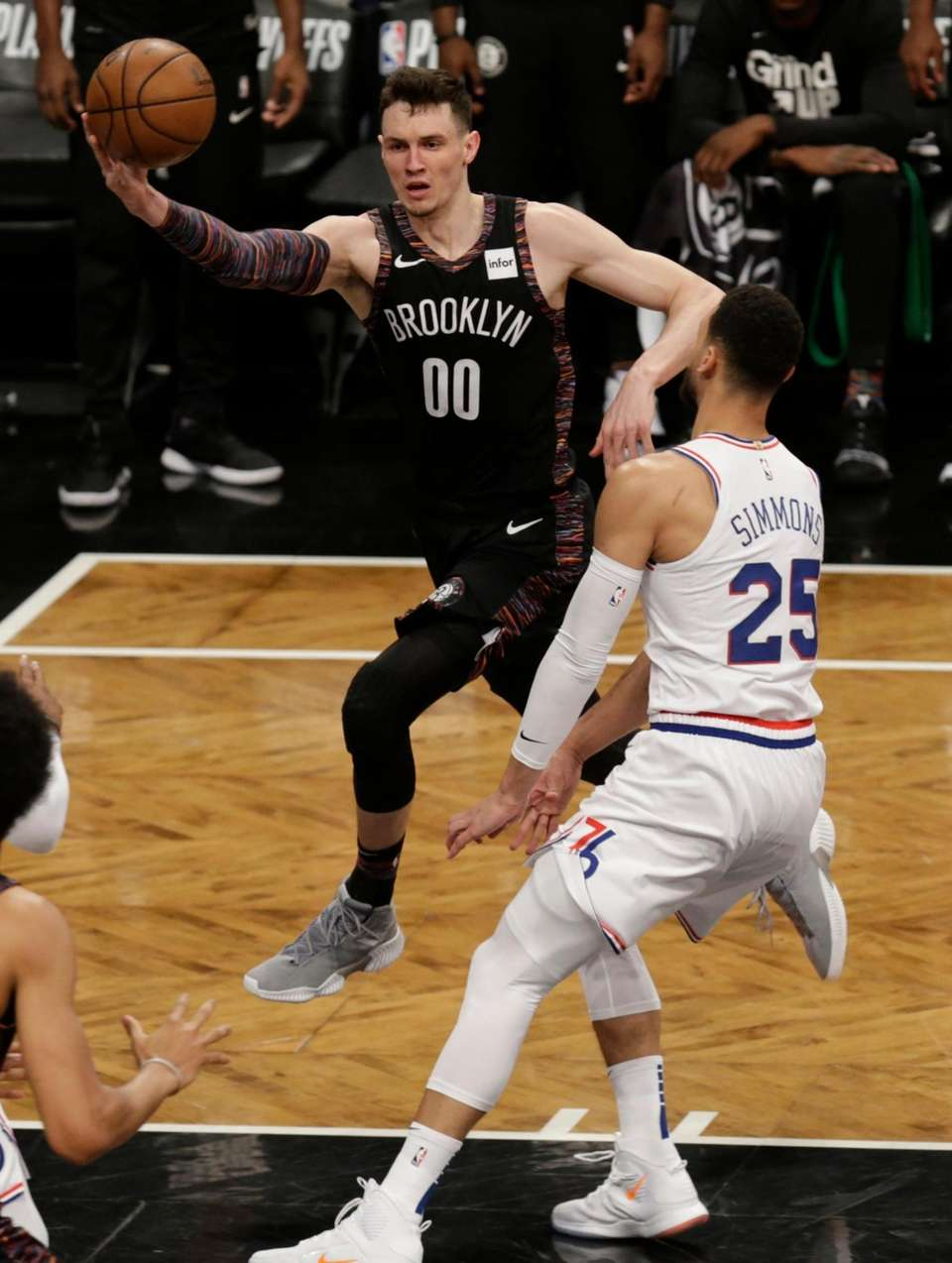 Nets forward Rodions Kurucs (00) drives on 76ers