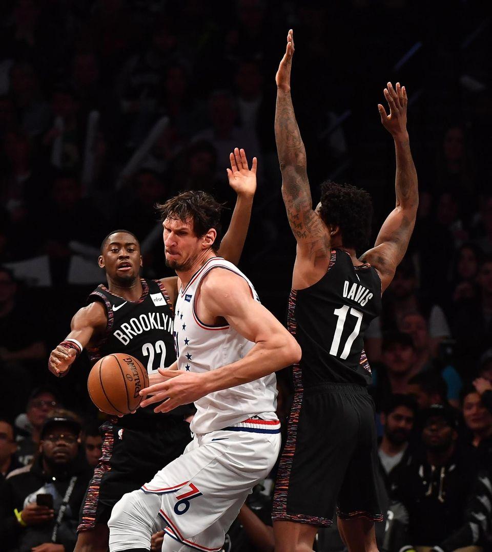 \Nets guard Caris LeVert (22) and Nets forward