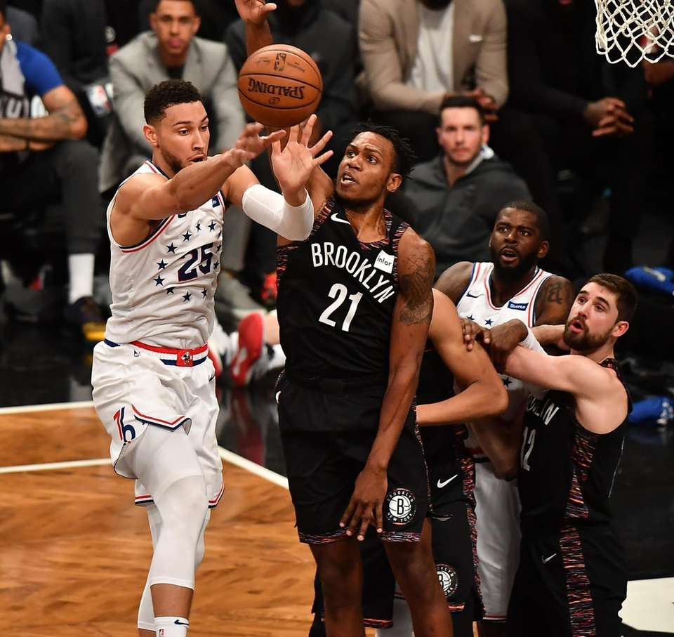 76ers guard Ben Simmons (25) drives on Nets