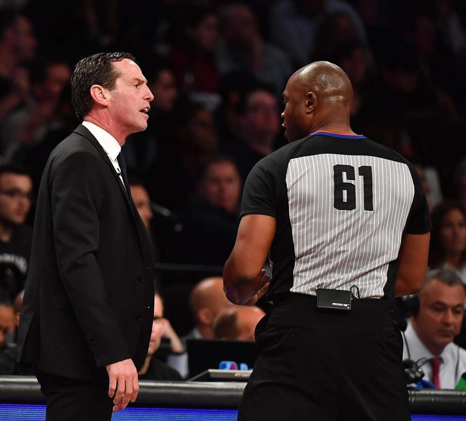 Nets head coach Kenny Atkinson argues with referee