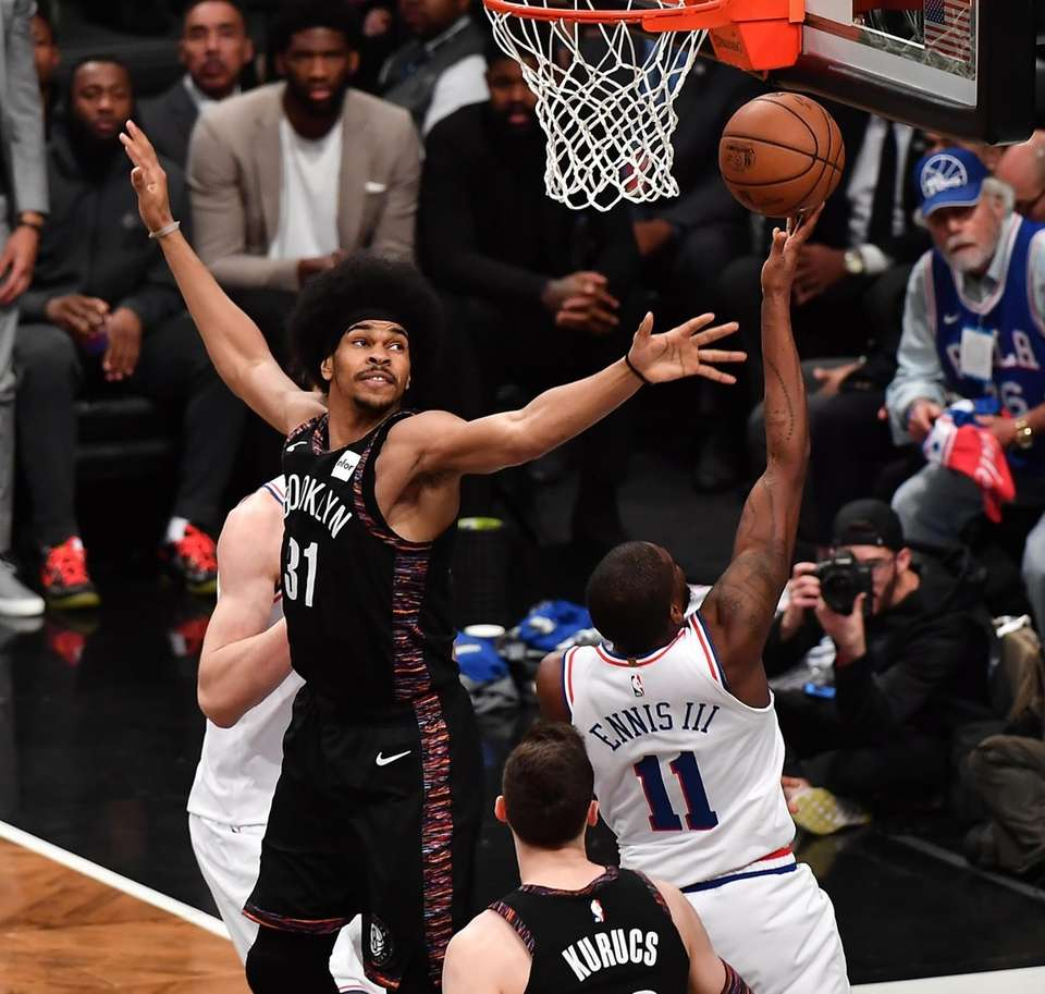 Nets center Jarrett Allen (31) defends on 76ers