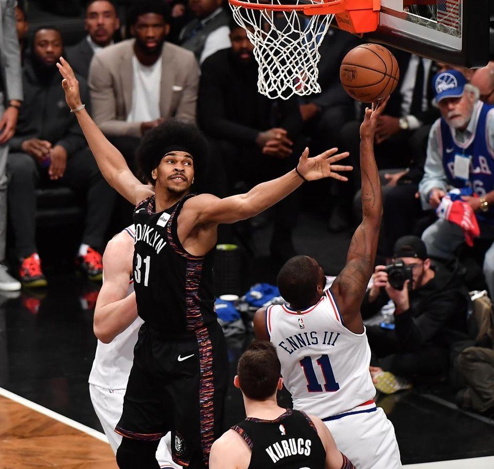 Nets center Jarrett Allen (31) defends on 76ers