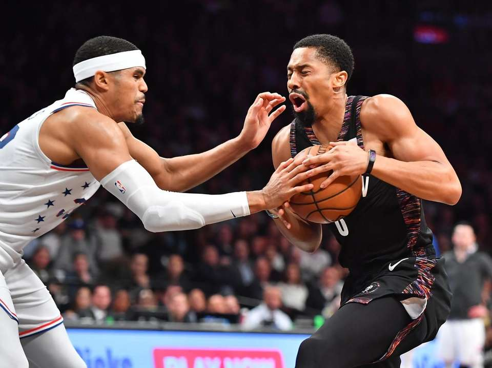 Nets guard Spencer Dinwiddie (8) drives on 76ers