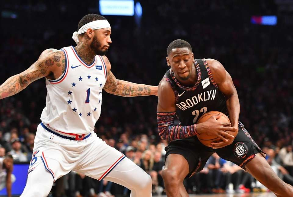 76ers forward Mike Scott (1) defends Nets guard
