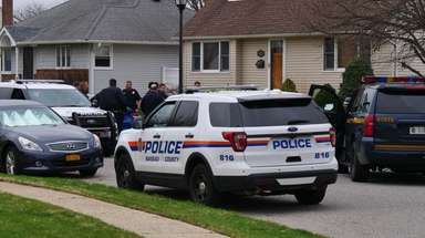Police converge on a Wantagh street where Nicholas