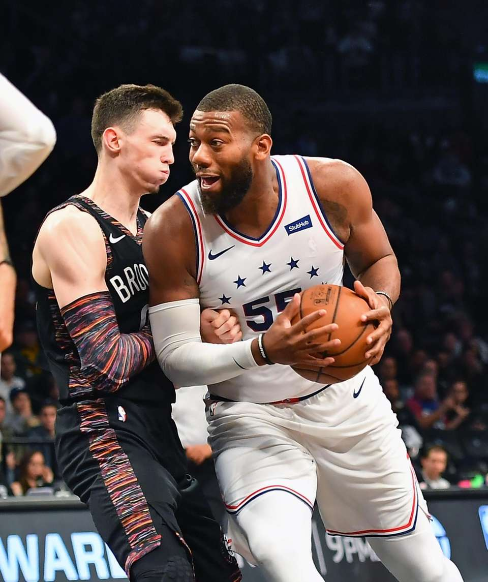 Nets forward Rodions Kurucs (00) defends 76ers center