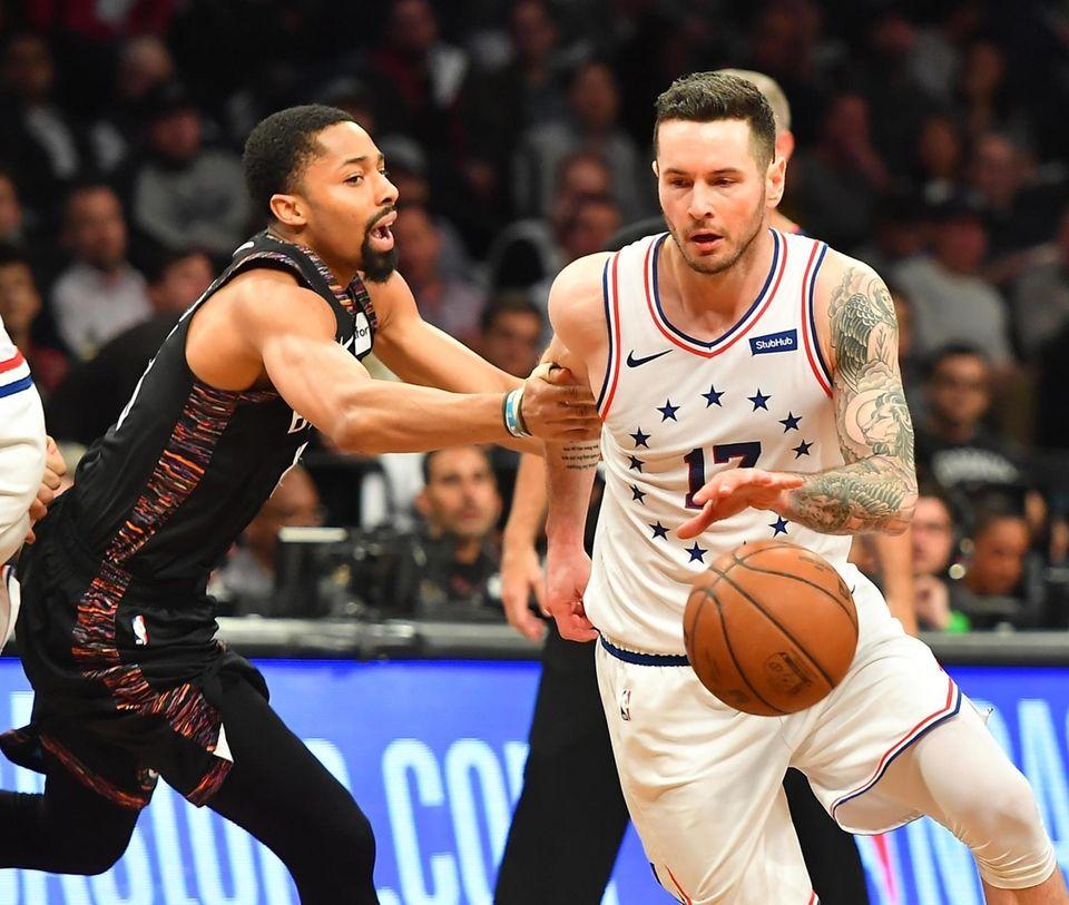 Nets guard Spencer Dinwiddie (8) defends 76ers guard