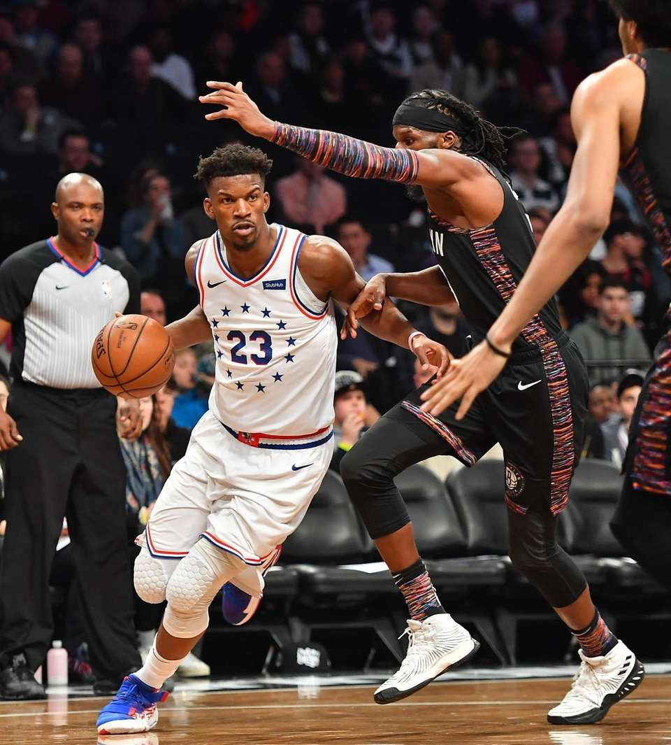 76ers guard Jimmy Butler (23) drives by Nets