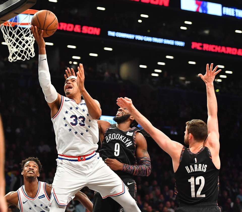 76ers forward Tobias Harris (33) drives on Nets
