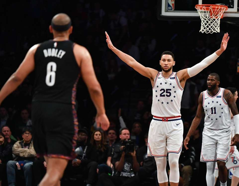 76ers guard Ben Simmons (25) celebrates in the