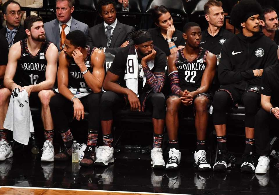 Nets forward Joe Harris (12) along with Nets