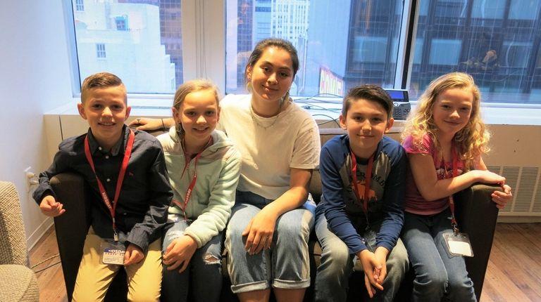 Singer Jasmine Thompson, center, with Kidsday reporters Dominic
