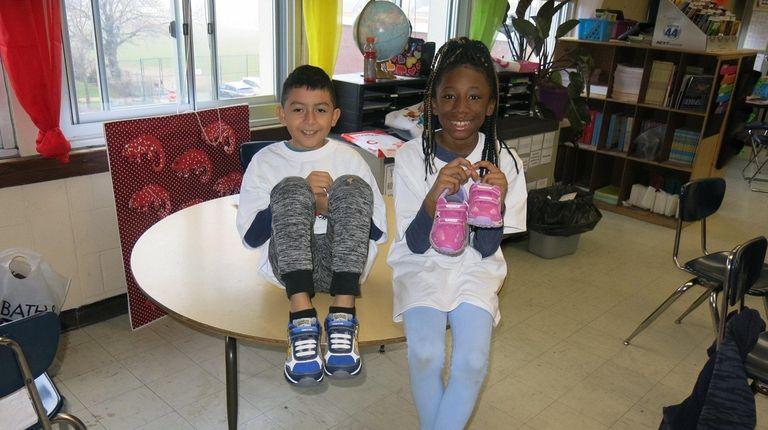 Justyn Mendez, left, and Kaliyah Ramsey, Kidsday Reporters,
