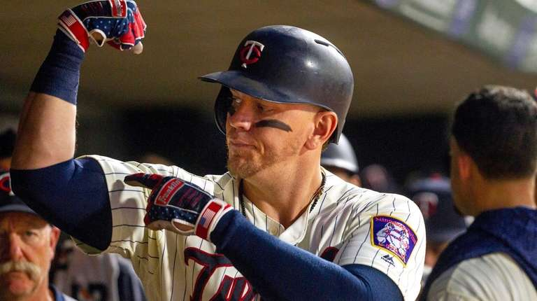 Minnesota's Logan Morrison celebrates his two-run homer on
