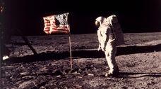 """Edwin E. """"Buzz"""" Aldrin Jr. near the flag"""