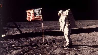 "Edwin E. ""Buzz"" Aldrin Jr. near the flag"