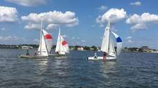 Kids are learning how to sail in Narrasketuck