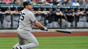 Yankees first baseman Mark Teixeira connects for a