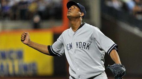Yankees starting pitcher Ivan Nova reacts after striking