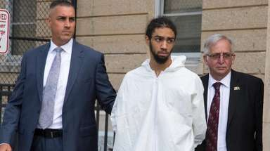 Deangelo Gill was escorted from Nassau Police headquarters