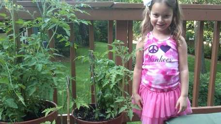 Emma Pnini, 5, of Roslyn, planted her own