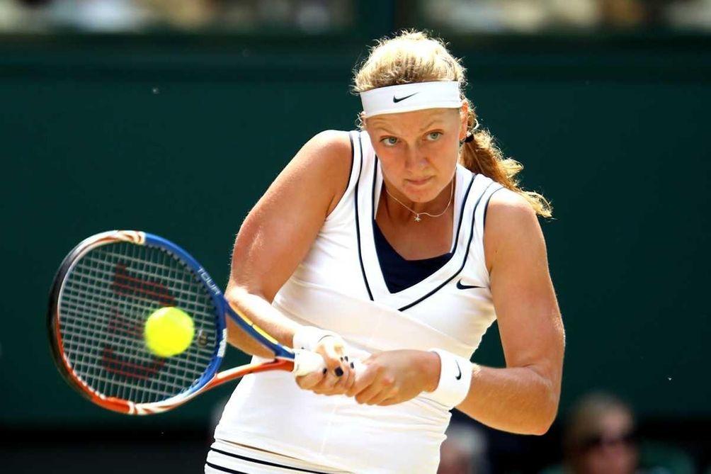 Petra Kvitova of the Czech Republic returns a