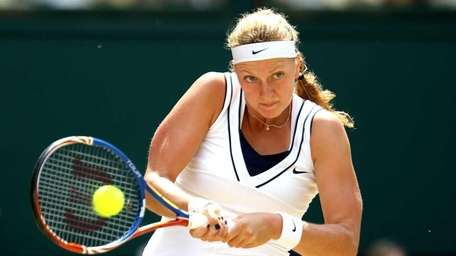 Petra Kvitova of the Czech Republic returns a