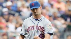 Jonathon Niese of the Mets celebrates a double