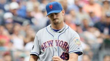 Jonathon Niese of the Mets celebrates a double