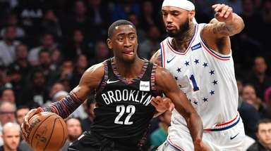 Nets guard Caris LeVert drives on 76ers forward